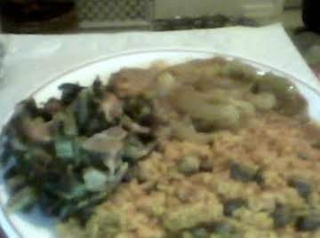 rice and gandules with pockchop and greens
