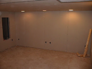 Photo: Screen wall with component rack opening on left.