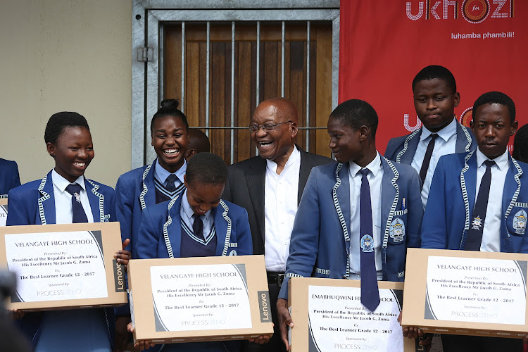 President Jacob Zuma with top achievers at the Velangaye High School in Nkandla on Wednesday.