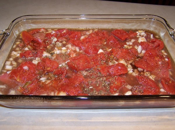Place the sirloin pieces in pan and spread the stewed tomatoes over them. Sprinkle...