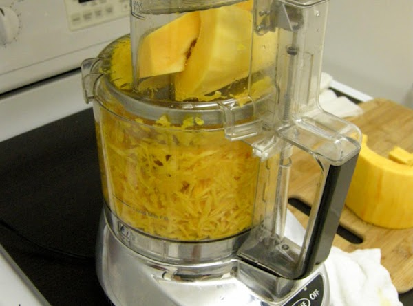 Preheat oven to 400  Grate squash in processor or grate box. Place in clean towel...