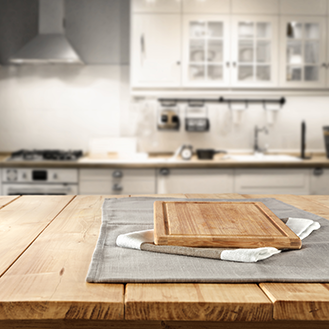 wooden chopping board on wooden table