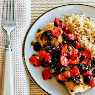 Hake Loins Baked with Tomato, Kalamata Olive, and Caper Salsa.