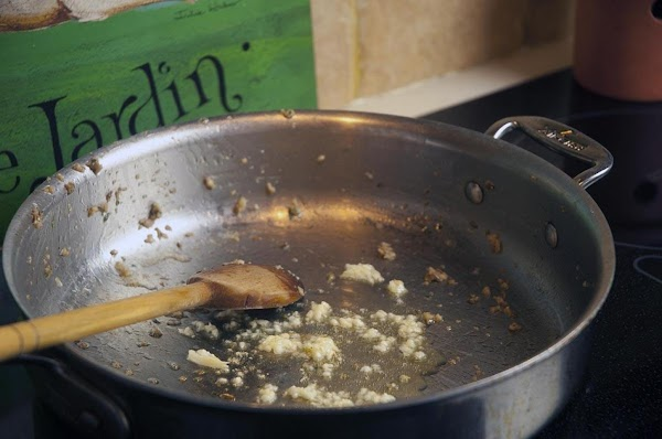 Add a bit of olive oil to the skillet, and sauté the garlic for...
