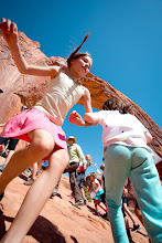 Photo: Two girls dancing… under Corona Arch during the  Adventure Rabbi Passover Seder and Retreat in Moab, Utah.
