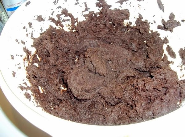 In a large bowl, combine the cake mix, butter, egg, vanilla and coffee; mix...