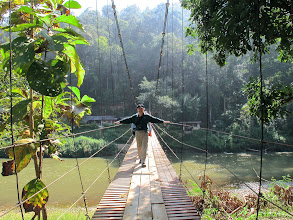 Photo: Jefferson crosses the Pai River on a swaying suspension bridge.