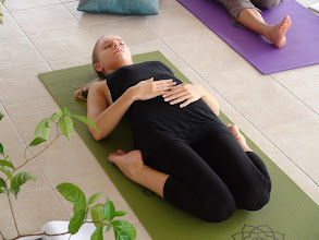 Photo: Yoga teacher trainee performing Paryankasana (Ham's Pose).