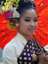 Photo: Pink Braces #vibrantwednesday #vividwednesday Curated by +Ajay Hatti and #womenwednesday Curated by +Niki Aguirre +Athena Carey +Lee Daniels +Christina Lawrie & +Teresa Stover :- Here's a shot of a Thai girl wearing traditional Thai dress in the Chiang Mai flower festival parade in northern Thailand.  Photography by Justin Hill ©