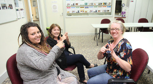 Rose Mangan and Linda Suey, pictured with instructor Johanna Lekke, have been learning about Auslan. Rose is learning sign language  to help with her work at the Mercy Centre in Hinds Street. But interested people are invited to learn Auslan as a recreation course which would also give them a valuable skill.