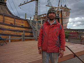 Photo: One of the builders poses in front of his ship.  The hull of this replica does not appear to be sealed, and is hence probably not seaworthy.