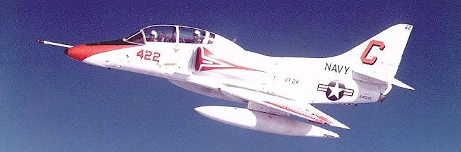"Photo: CDR John Alger, VT 24 '73-79 and LT. Dave ""Shrantz"" Erickson flying the ""Photo Bird"""