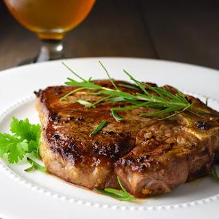 T-Bone Steak with Garlic and Rosemary.