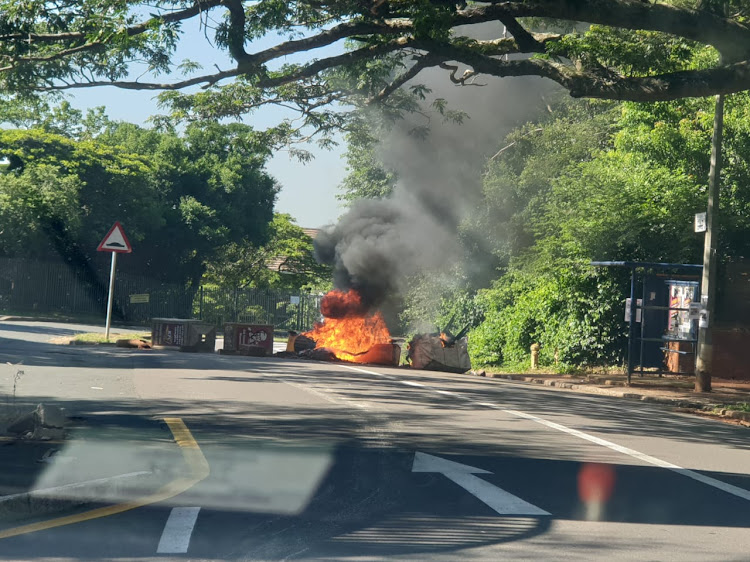 Protesting students allegedly burnt DSW bins near the Howard College main entrance on Wednesday, shortly after a security building was set alight at Westville campus.