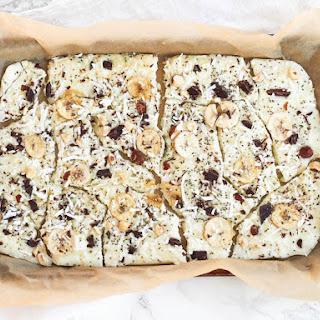 Frozen Yogurt Bark with Dark Chocolate, Bananas and Hazelnuts.