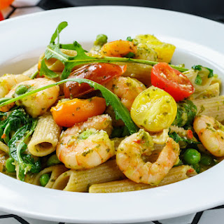 Shrimp Pasta with pesto and cherry tomatoes.