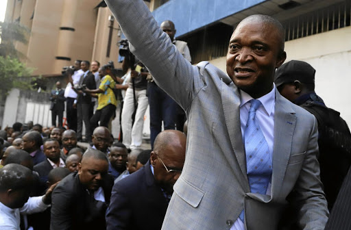 Party politics: Former Congolese interior minister Emmanuel Ramazani Shadary waves to his supporters as he arrives on Wednesday to file his candidacy for presidential elections at the DRC's electoral commission head offices in the Gombe municipality in Kinshasa. Picture: REUTERS