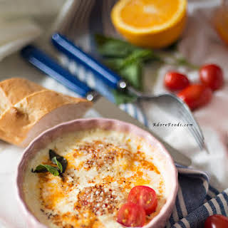Baked Eggs with Tomatoes, Parmesan and Cream.