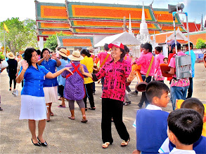 Photo: teachers dance to the long drum music