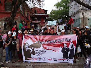 Photo: 3.31.14 street lamp demonstration in Nepal