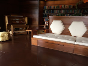 Photo: Frank Lloyd Wright designed most of the furniture too. Note the hexagonal pillows.