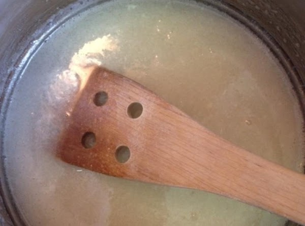 In a saucepan over MEDIUM heat, bring the sugar and milk to a boil,...