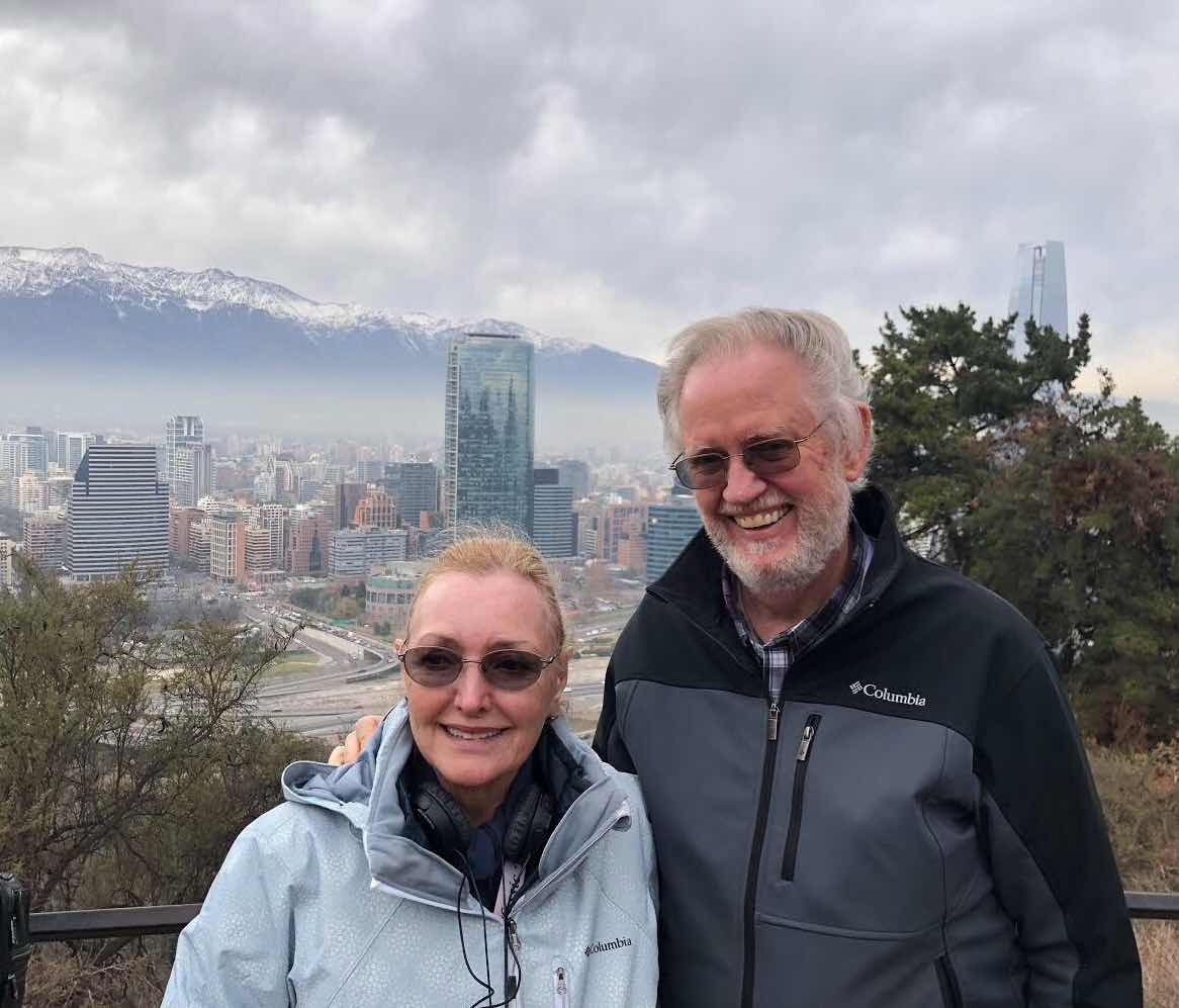 Resident Astronomers enjoy the view of downtown Santiago, with Andes and tallest building in Sur America (Source: Palmia Observatory)