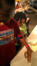 Photo: Q and Kaleya working on their house