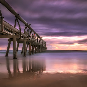 Somber Sunrise by Alex Bogdan - Landscapes Waterscapes ( clouds, sand, sky, cloudscape, reflections, ocean, long exposure, beach, jetty, sunrise, wharf, morning )
