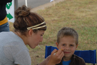 Photo: Chelsea Studenski paints a childs face at the Camp Ripley Open House.