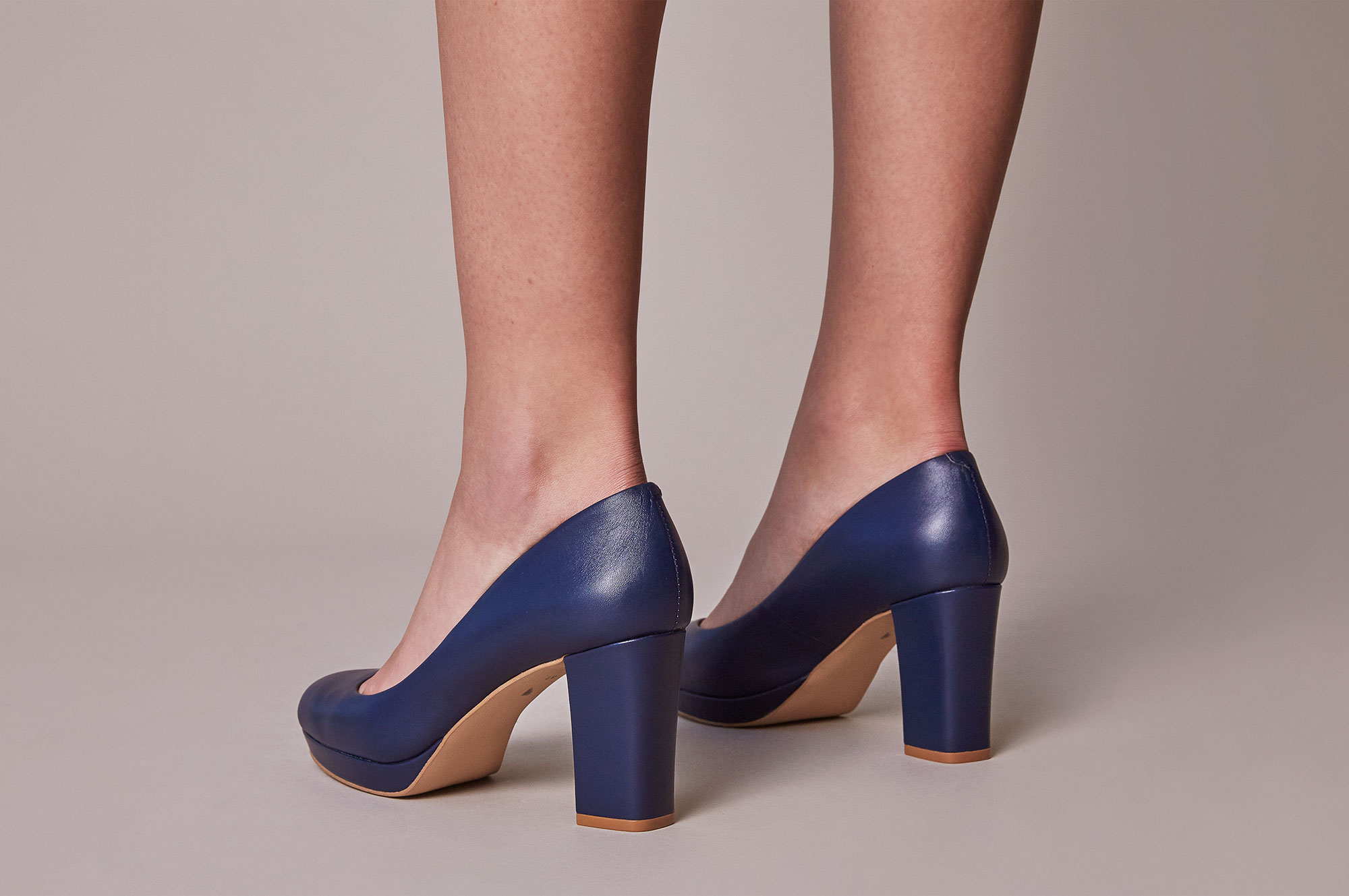 Design your own shoes. 3.5 inch navy leather heels