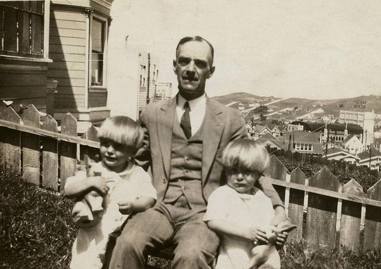 Leslie, his grandfather James Jones, and twin brother Norman, circa 1929