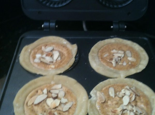 Divide the filling among the 4 crusts and spread evenly.  The remaining almonds are used...