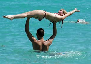 Photo: man holding woman in air at beach. cuba. Tracey Eaton photo
