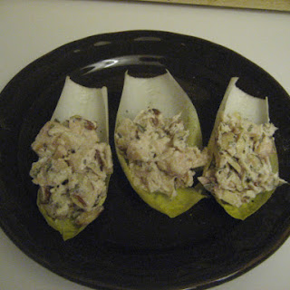 Tarragon Chicken Salad With Sliced Almonds In Endive Leaves