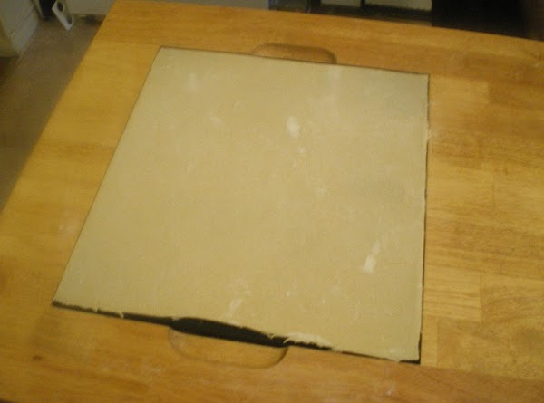 Divide dough in half.  Place one half on counter and roll into a...