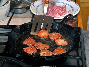 Photo: frying the pork patties until browned and crusty