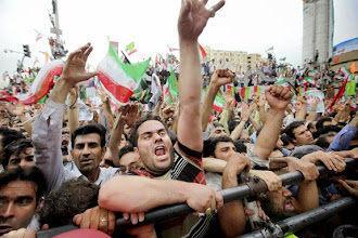 """Photo: Tens of thousands of supporters of Iranian President Mahmoud Ahmadinejad gather in Vali Asr square for a rally attended by the president, in Tehran, Iran Sunday, June 14, 2009. Protesters set fires and smashed store windows Sunday in a second day of violence as groups challenging President Mahmoud Ahmadinejad's re-election tried to keep pressure on authorities but Ahmadinejad dismissed the unrest, the worst in a decade in Tehran, as """"not important."""" (AP Photo/Ben Curtis)   Original Filename: Mideast_Iran_Election_ABC108.jpg"""