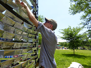 Photo: Roger's son Jason makes sure the new plaques are attached firmly.