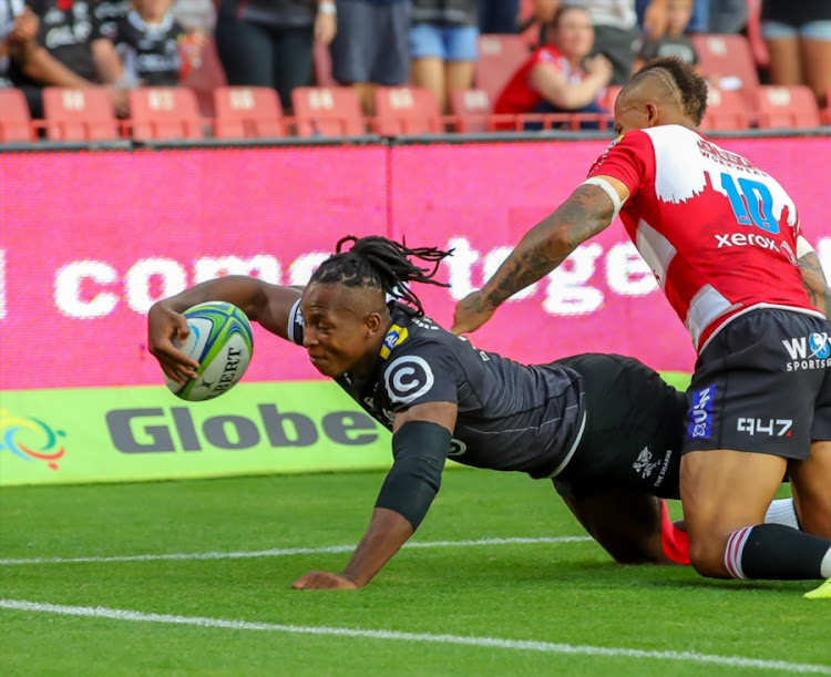 Sbu Nkosi of the Cell C Sharks scores a try against the Lions. Nkosi is one of the six uncapped players named in Springboks head coach Rassie Erasmus's Bok camp.