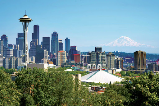 Seattle-Skyline.jpg - See Seattle, with Mt. Rainier looming in the distance, on a vacation to the Pacific Northwest with American Cruise Lines.