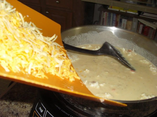 Remove from heat, put in cheeses and stir to melt.