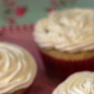 Golden Vanilla Cupcakes with Fluffy Buttercream Frosting.