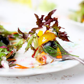 Fresh Herb and Edible Flower Salad with Hibiscus Champagne Vinaigrette.