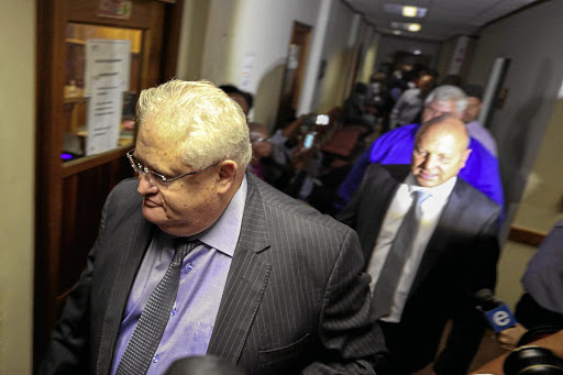 Former Bosasa COO Angelo Agrizzi, left. Behind him are Frans Vorster and Andries van Tonder. A number of Bosasa executives were arrested by Hawks officers this week in connection with a string of corruption allegations involving tenders with the department of correctional services.