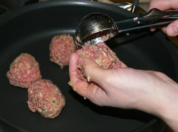 In large bowl beat eggs, garlic, and parsley. Crumble the beef over the mixture...