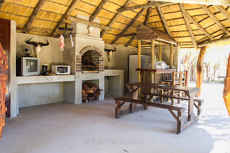 Photo: Log cabin kitchen and braai area