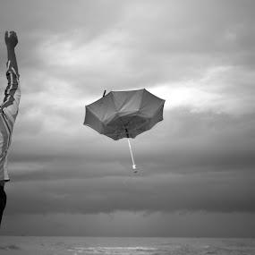 Monsoon by Krishnan Soundararajan - Black & White Street & Candid