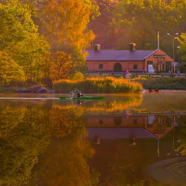 Perfect morning by Roger Carlsson - Landscapes Waterscapes ( mirror, flag, reflections, canoe, biker, swan, water, colors, sea, autumn leaves, brick building, autumn, kayak, splash )