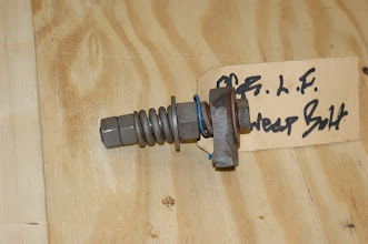 """Photo: Left Front Rail Sweep Mounting Hardware  (As received from OCR and removed off the chassis.)  This h/w appeared to be not original as a 3/4"""" nut was used as a spacer. As both bolts were bent. New mounting h/w was purchased.  Photo by J. Loucks"""